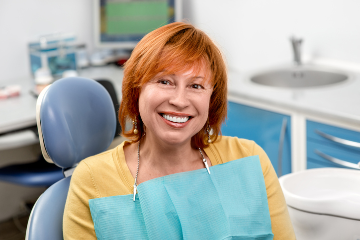 Woman happy about her dental cleaning